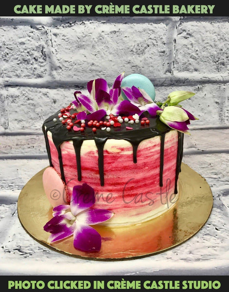 Chocolate And Pink Drip Cake - cremecastle