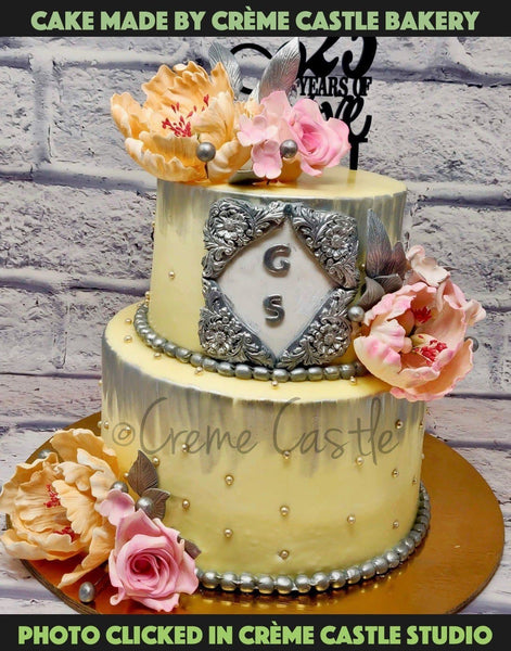 A Floral Themed Cake With Pastel Colors To Give It Vintage Victorian Look. The Delicately Handcrafted Flowers Grace The Cake With Even More Elegant Look.
