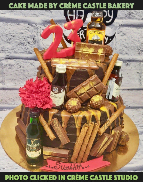 A Cake For Someone Who Loves Only Two Things, Whiskey And Chocolate. A Tier Cake With Chocolate Dripping All Over And Whiskey Miniatures All Over The Cake. The Alcohol Is Given By The Client. In No Way We Deal In Alcohol And By Selling Or Buying.