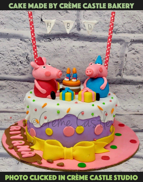 A Peppa pig theme cake in purple and pink theme. With 3D Peppa figures on top along with cakes and gits.