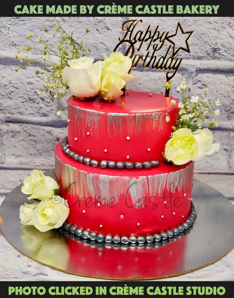 A red theme wedding/engagement with cake with real flowers all over the cake