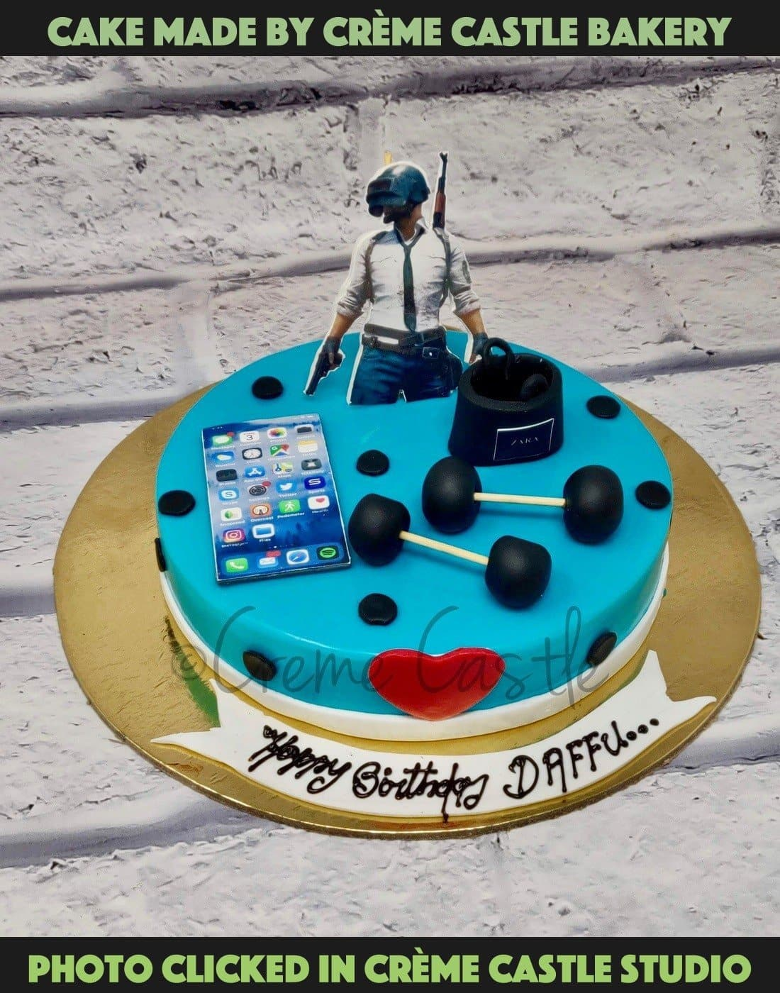 A cake for someone who loves two things Pubg game and gumming. A cake personifying the same