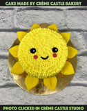 A cake in the form of a sun with rays made from fondant coming out from the edges