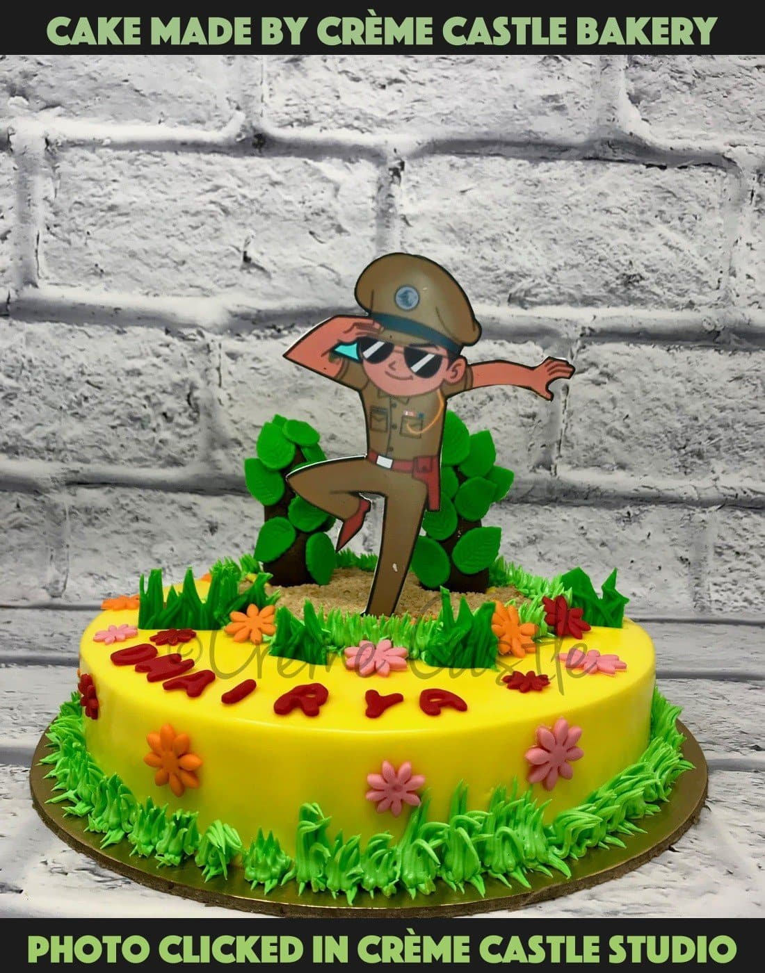 A little singham theme cake in yellow and green theme with Little Singham character in 2D at top of the cake