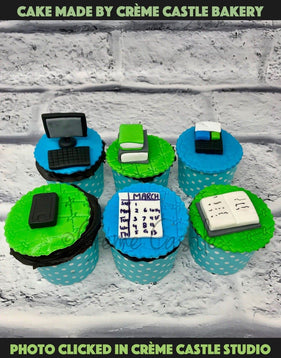 A corporate theme set of 6 cupcakes with office and work elements on each