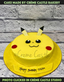 A yellow color cake in the form of Pikachu's face for a Pokemon lover