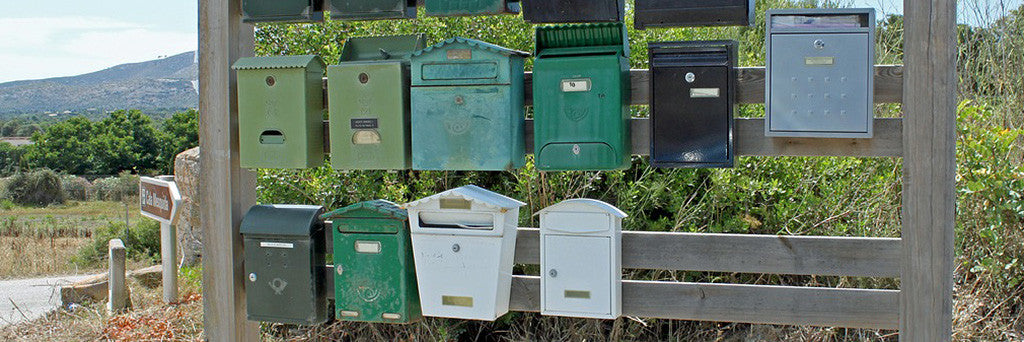 A jumble of colourful mail boxes