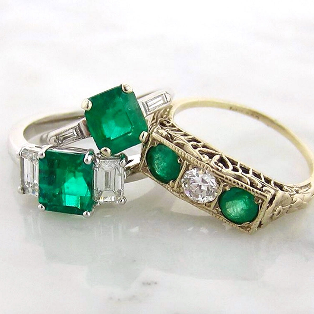 Doyle & Doyle vintage emerald and diamond rings