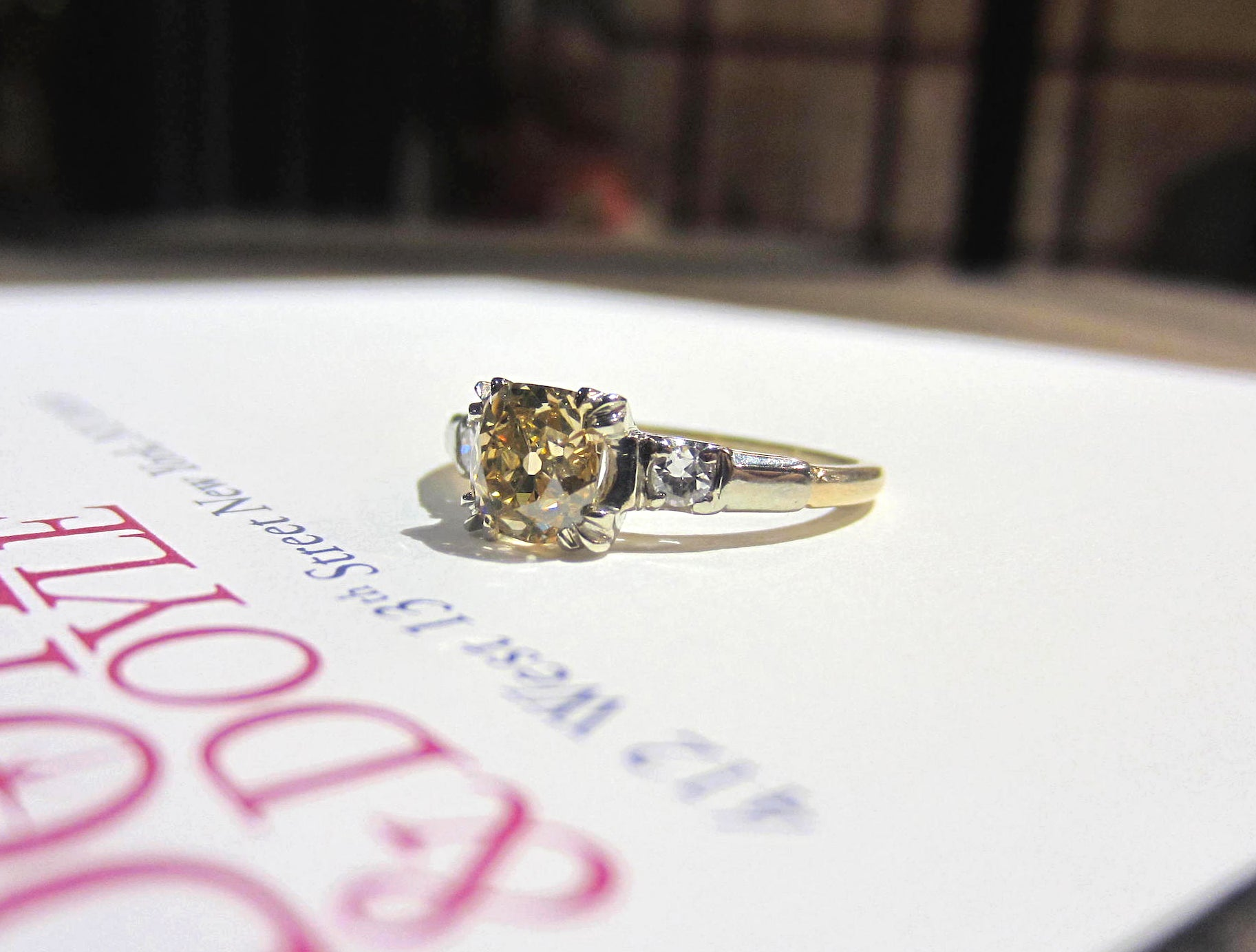 Vintage fancy yellow diamond engagement ring in gold from Doyle & Doyle