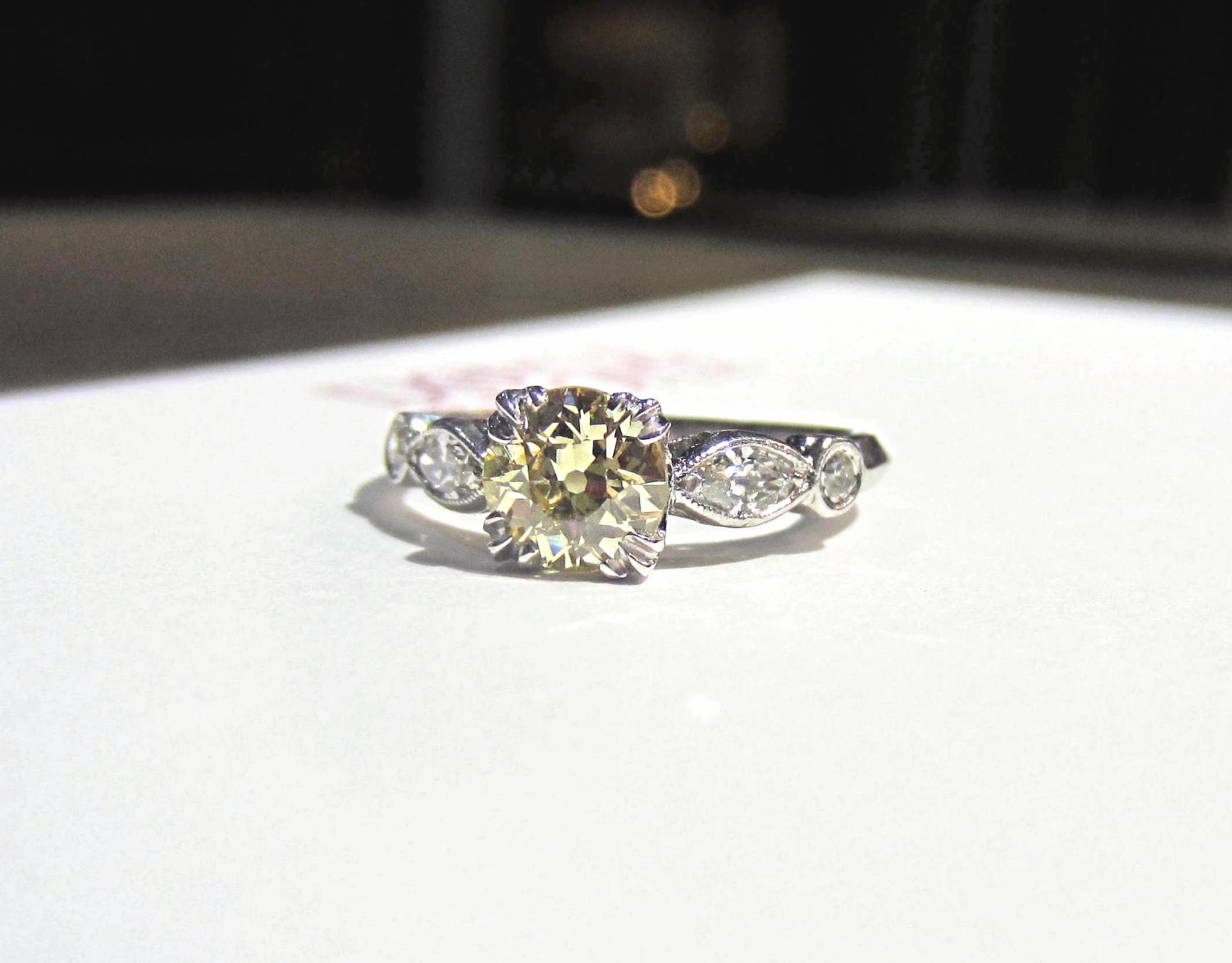 Vintage fancy yellow diamond engagement ring in platinum from Doyle & Doyle
