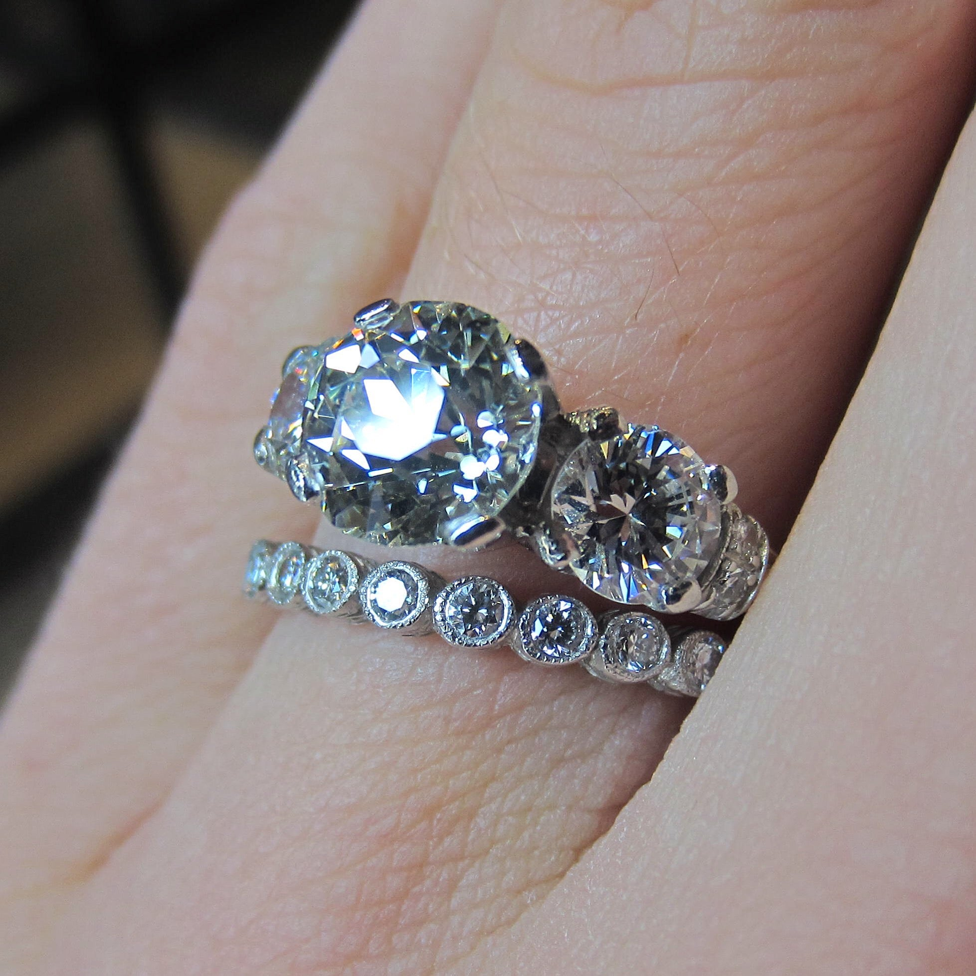Three stone diamond engagement ring and wedding band from Doyle & Doyle