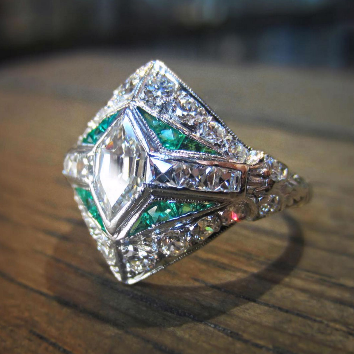 Doyle & Doyle vintage diamond emerald engagement ring.