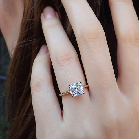 Doyle & Doyle vintage cushion cut diamond solitaire engagement ring.
