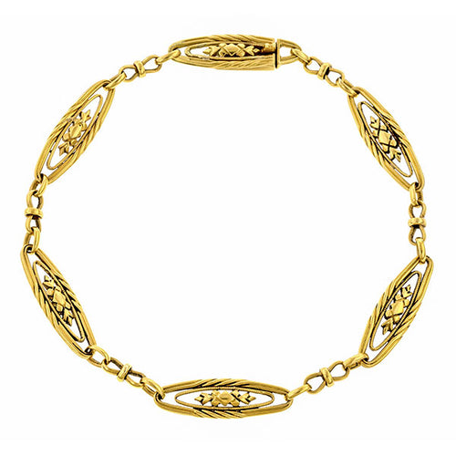 Edwardian bracelet: a Yellow Gold Ornate Link Bracelet sold by Doyle & Doyle vintage and antique jewelry boutique.
