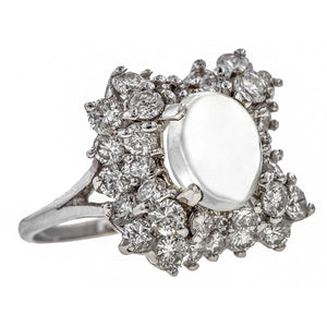 Vintage Ring: a 14k White Gold Cluster of Round Brilliant Cut Diamonds With Moonstone Ring sold by Doyle & Doyle vintage and antique jewelry boutique