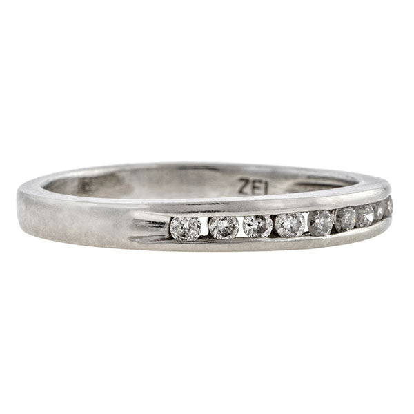 Estate ring: a Platinum Wedding Band With Round Brilliant Cut Diamonds sold by Doyle & Doyle vintage and antique jewelry boutique.