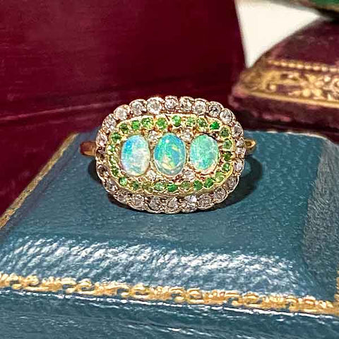 Edwardian Opal, Demantoid & Diamond Ring sold by Doyle and Doyle an antique and vintage jewelry boutique