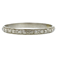 Art Deco ring; a Platinum Repeated Flower Design Pattern Wedding Band sold by Doyle & Doyle vintage and antique jewelry boutique.