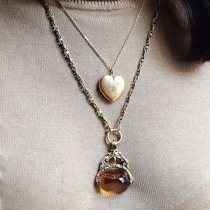 Antique Locket: Heart Shaped Diamond Locket, sold by Doyle & Doyle an antique and vintage jewelry store.