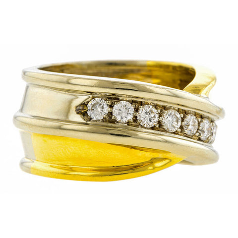 Vintage ring: a Yellow & White Two-tone Gold Diamond Crossover Wedding Band sold by Doyle & Doyle vintage and antique jewelry boutique.