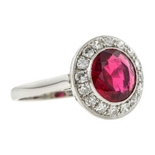 Estate ring: a Platinum Red Spinel And Diamond Halo 2.27ct. Engagement Ring sold by Doyle & Doyle vintage and antique jewelry boutique.