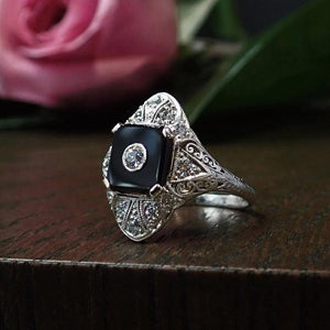Art Deco onyx and diamond filigree engagement ring from Doyle & Doyle in New York