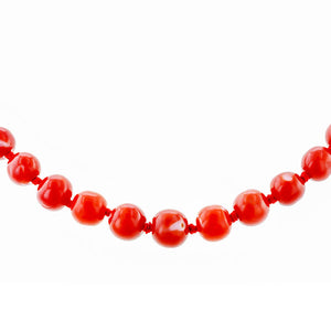 Antique Coral Bead NecklaceAntique Coral Bead Necklace, a necklace with coral beads and yellow gold clasp, sold by Doyle & Doyle vintage and antique jewelry boutique.