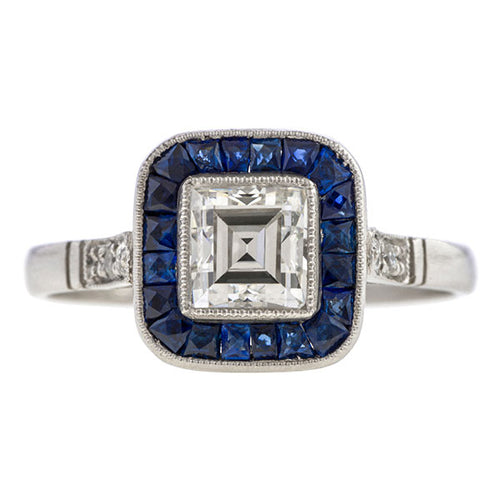 Art Deco ring: a Platinum Emerald, Round Brilliant Cut Diamond And Sapphire Engagement Ring sold by Doyle & Doyle vintage and antique jewelry boutique.