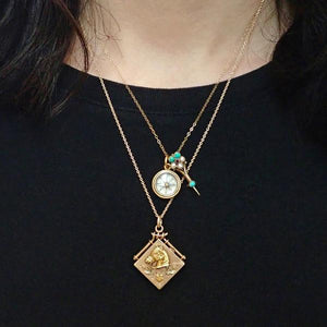 Victorian layered antique gold necklaces, horse locket, compass pendant from Doyle & Doyle 107658N 107656P 107576N