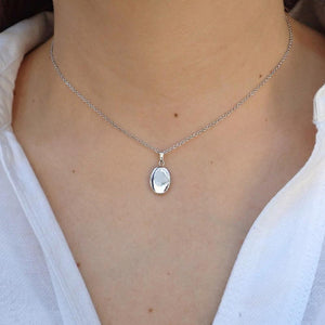 Locket necklace: Sterling Silver Oval Locket Necklace, sold by Doyle & Doyle jewelry boutique