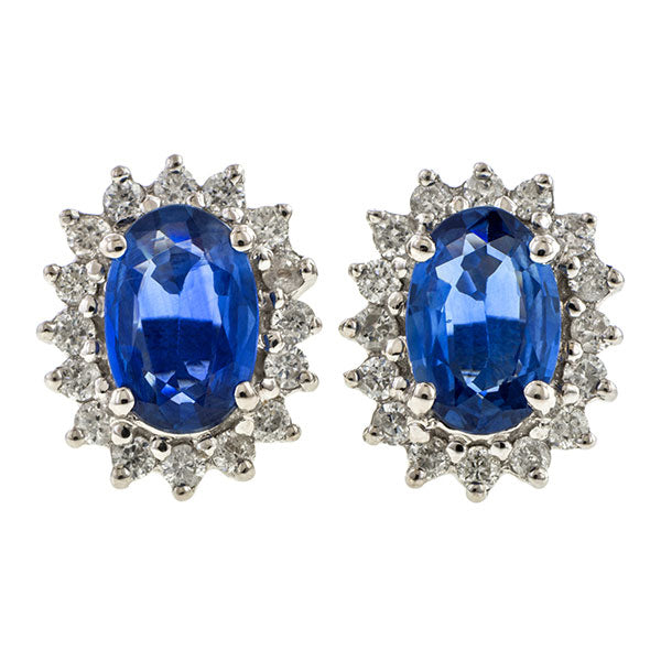 Sapphire & Diamond Earrings, set with sapphires and a frame of diamonds set in white gold, sold by Doyle & Doyle vintage and antique jewelry boutique.