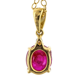 Pendant: a Yellow Gold With Oval Ruby And Diamond Pendant sold by Doyle & Doyle vintage and antique jewelry boutique.