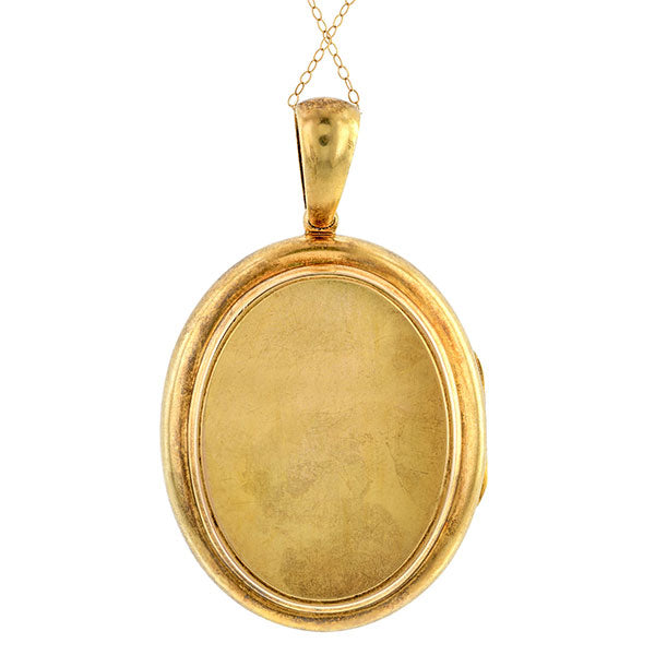Victorian locket: a Yellow Gold Oval Locket sold by Doyle & Doyle vintage and antique jewelry boutique.