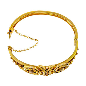 Victorian Bangle Bracelet, a Victorian bangle bracelet with horseshoe motif, in yellow gold, sold by Doyle & Doyle vintage and antique jewelry boutique.