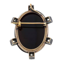Victorian brooches: a Silver-Topped 14k Rose Gold Black Onyx Cameo With Old European Diamonds Pin sold by Doyle & Doyle vintage and antique jewelry boutique.