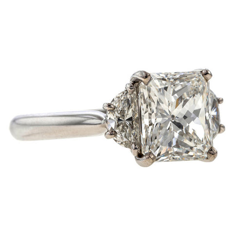 Vintage ring: a Platinum Radiant Cut And Two Half Moon Diamonds Engagement Ring sold by Doyle & Doyle vintage and antique jewelry boutique.