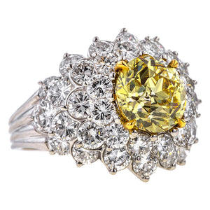 Vintage ring: a Platinum Yellow Diamond Cluster Ring, Old European cut 3.03ct. Cut Engagement Ring sold by Doyle & Doyle a vintage and antique jewelry boutique.