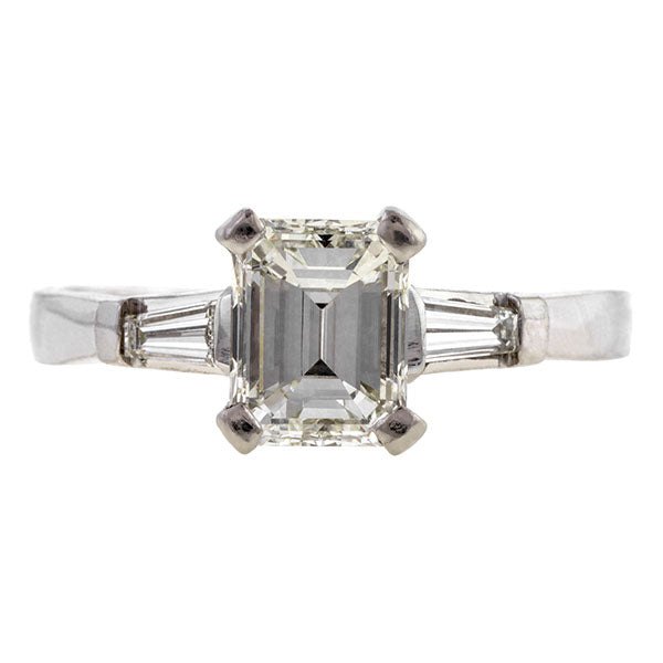 Estate ring: a Platinum Engagement Ring,  Emerald Cut, sold by Doyle & Doyle vintage and antique jewelry boutique.