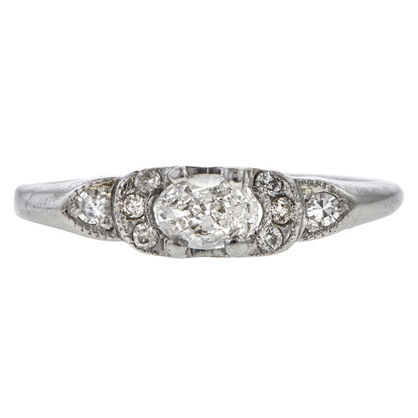 Art Deco ring: a Platinum Engagement Ring With Oval and Round Brilliant Cut Diamonds sold by Doyle & Doyle vintage and antique jewelry boutique.