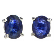 Contemporary earrings: a White Gold Oval Sapphire Stud Earrings sold by Doyle & Doyle vintage and antique jewelry boutique.