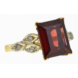 Vintage ring: a White And Yellow Gold With Rectangular Garnet Ring sold by Doyle & Doyle vintage and antique jewelry boutique.
