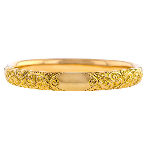 Vintage bracelet: a Yellow Gold With A Scroll Motif Bangle sold by Doyle & Doyle vintage and antique jewelry boutique.