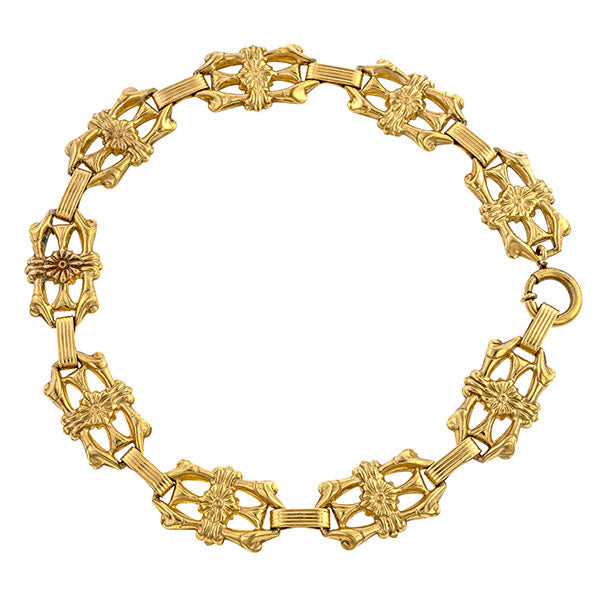 Vintage bracelets: a Yellow Gold Ornate Floral Motif Link Bracelet sold by Doyle & Doyle vintage and antique jewelry boutique.
