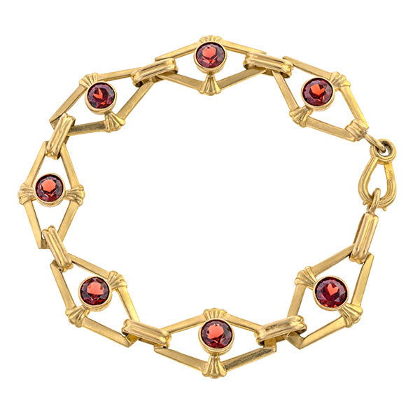 Vintage bracelet: a Yellow Gold And Garnets Link Bracelet sold by Doyle & Doyle vintage and antique jewelry boutique.