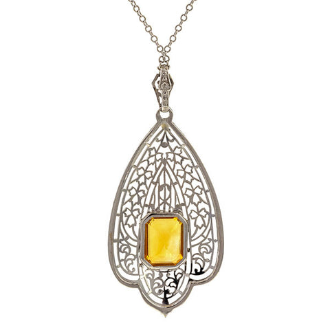 Vintage necklace: a White Gold Filigree Emerald Cut Citrine Pendant sold by Doyle & Doyle vintage and antique jewelry boutique.