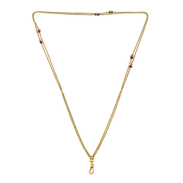 Vintage necklace: a Yellow Gold With Rock Crystal And Garnet Chain sold by Doyle & Doyle vintage and antique jewelry boutique.