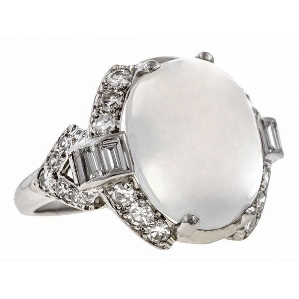 Art Deco ring: a Platinum Oval Moonstone And Baguette Cut Diamond Ring sold by Doyle & Doyle vintage and antique jewelry boutique.
