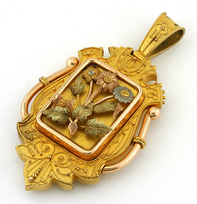 Victorian Etruscan Revival Locket, sold by Doyle & Doyle an antique and vintage jewelry store.