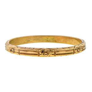 Vintage ring: a Rose Gold Patterned Wedding Band sold by Doyle & Doyle vintage and antique jewelry boutique.