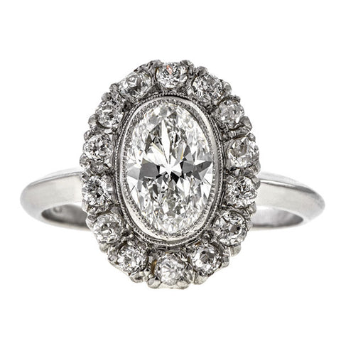 Vintage ring: a Platinum Cluster Old European And Swiss Cut Diamond Engagement Rings sold by Doyle & Doyle vintage and antique jewelry boutique.